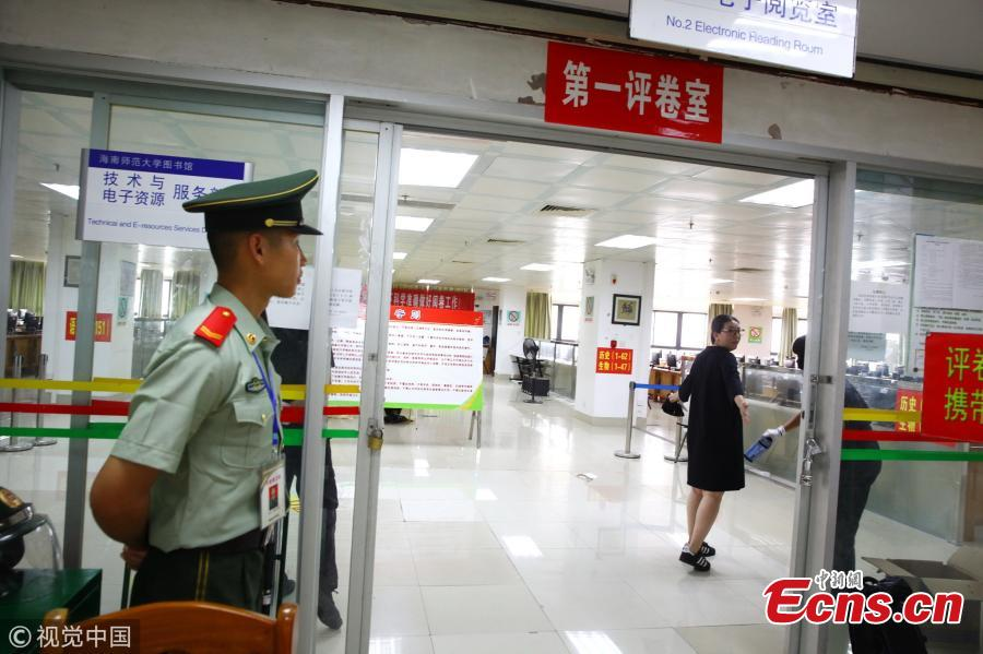 A paramilitary police officer stands guard at a site where the test papers of the national college entrance exam, known as gaokao, are being graded at Hainan Normal University in Haikou City, South China's Hainan Province, June 12, 2018. The province's 699 teachers will be responsible for grading gaokao test papers from June 14 to 20 at well-guarded sites. (Photo/VCG)