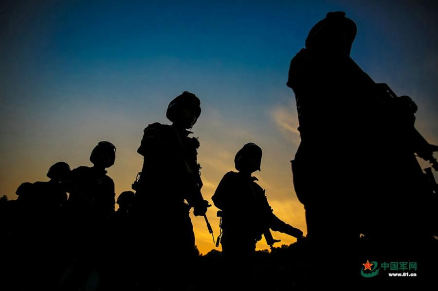 A group of soldiers march along a road during the week-long rigorous training starting from June 11, 2018. (Photo/81.cn)