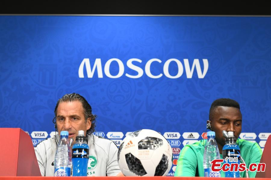 Saudi Arabia coach Juan Antonio Pizzi (L) and footballer Osama Hawsawi attend a press conference in Moscow, Russia, June 13, 2018, ahead of the World Cup. (Photo: China News Service/Tian Bochuan)