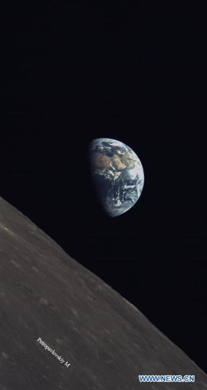 A released photo shows part of the moon with the earth as background. China and Saudi Arabia on June 14, 2018 jointly unveiled three lunar images acquired through cooperation on the relay satellite mission for Chang\'e-4 lunar probe. An optical camera, developed by the King Abdulaziz City for Science and Technology of Saudi Arabia, was installed on a micro satellite, named Longjiang-2. The micro satellite is orbiting around the Moon. The camera, which began to work on May 28, has conducted observations of the Moon and acquired a series of clear lunar images and data. (Xinhua)