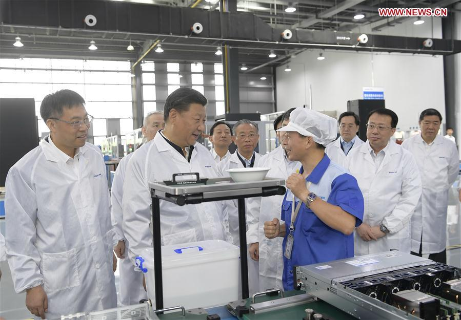 Chinese President Xi Jinping, also general secretary of the Communist Party of China (CPC) Central Committee and chairman of the Central Military Commission, visits a high-end fault tolerant computer production base of the Inspur Group in the high-tech zone of Jinan, capital of east China\'s Shandong Province, June 14, 2018. Xi made an inspection tour in Shandong from June 12 to 14. (Xinhua/Li Xueren)