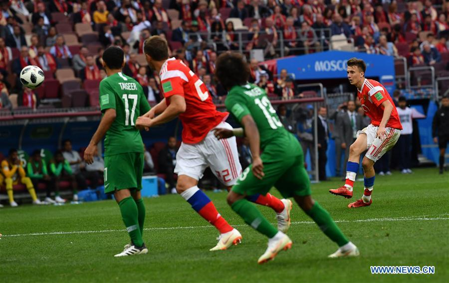 Russia\'s Aleksandr Golovin (1st R) scores a goal from a free kick against Saudi Arabia during the opening match of the 2018 FIFA World Cup in Moscow, Russia, on June 14, 2018. Russia won 5-0. (Xinhua/Chen Cheng)