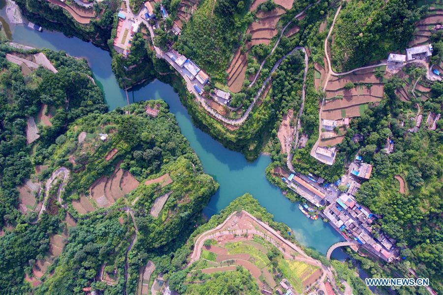 Aerial photo taken on June 12, 2018 shows Shenlongwan Village in Changzhi City, north China\'s Shanxi Province. A 1,526-meter-long road was built along the cliffs to connect isolated Shenlongwan to the outside. The construction of this miraculous road lasted for fifteen years from 1985 to 2000, and was built purely by villagers of Shenlongwan. Thanks to this road, villagers here now cast off poverty by developing tourism. (Xinhua/Cao Yang)