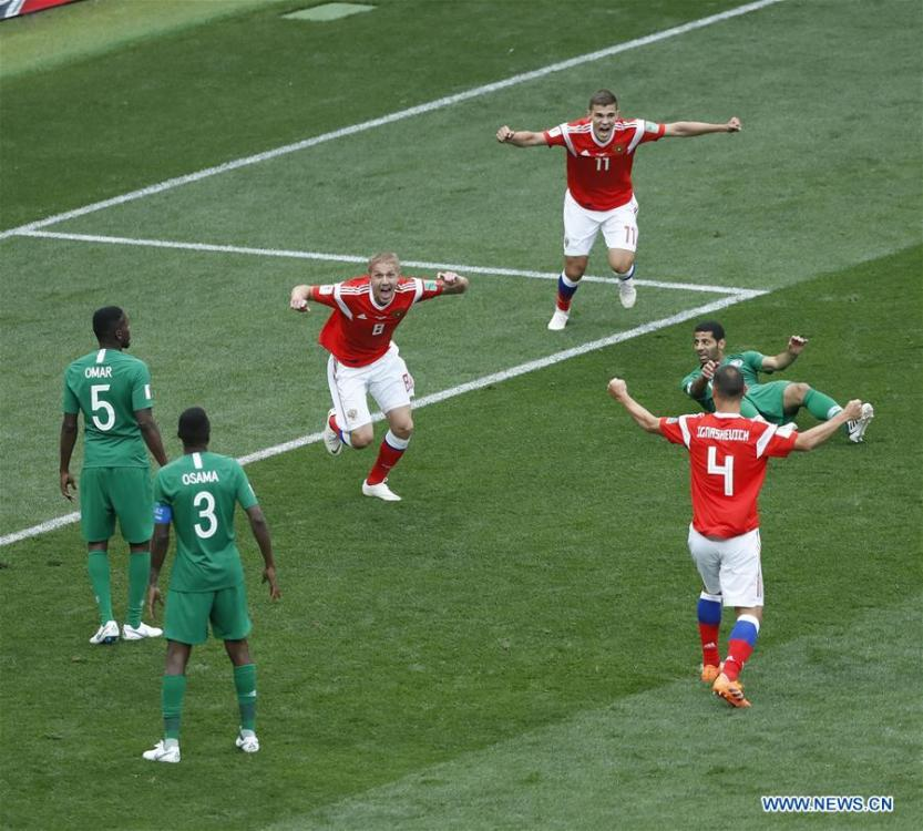 Russia\'s Iury Gazinsky (C) celebrates his first goal during the opening match of the 2018 FIFA World Cup in Moscow, Russia, on June 14, 2018. (Xinhua/Cao Can)