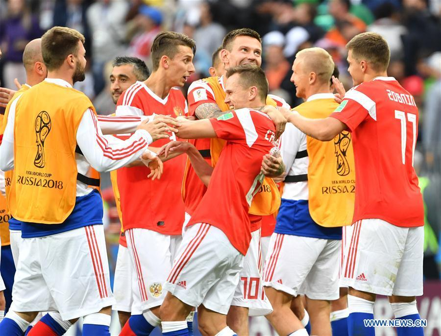 Russia\'s players celebrate their victory against Saudi Arabia during the opening match of the 2018 FIFA World Cup in Moscow, Russia, on June 14, 2018. Russia won 5-0. (Xinhua/Liu Dawei)