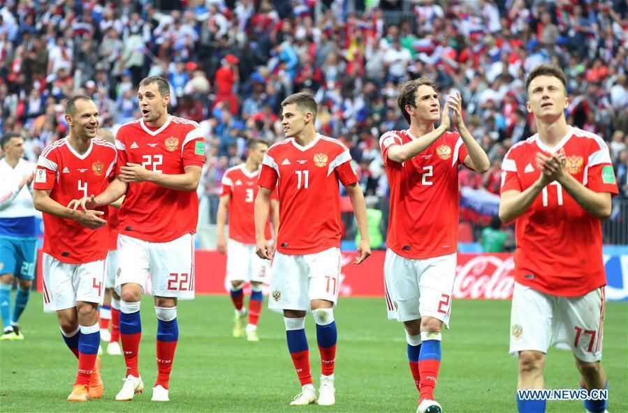 Russia\'s players celebrate their victory against Saudi Arabia during the opening match of the 2018 FIFA World Cup in Moscow, Russia, on June 14, 2018. Russia won 5-0. (Xinhua/Yang Lei)