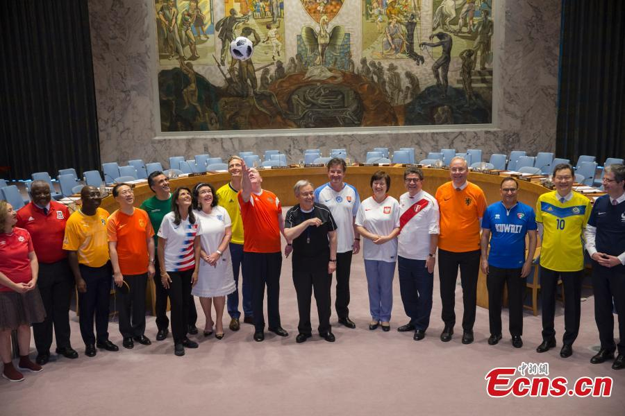 Members of the United Nations Security Council pose for a picture while wearing soccer jerseys to commemorate the inauguration of the World Cup, at the United Nations headquarters in New York City, New York, U.S, June 14, 2018. (Photo: China News Service/Liao Pan)