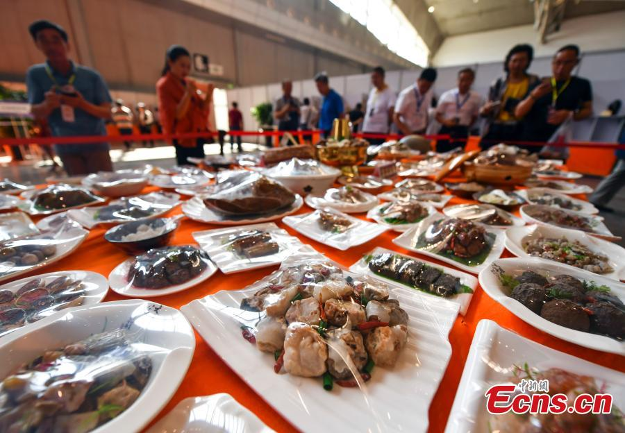 A stone banquet made of rare stones is on display at an exhibition center in Urumqi, capital of northwest China\'s Xinjiang Uygur Autonomous Region, June 15, 2018. (Photo: China News Service/Liu Xin)