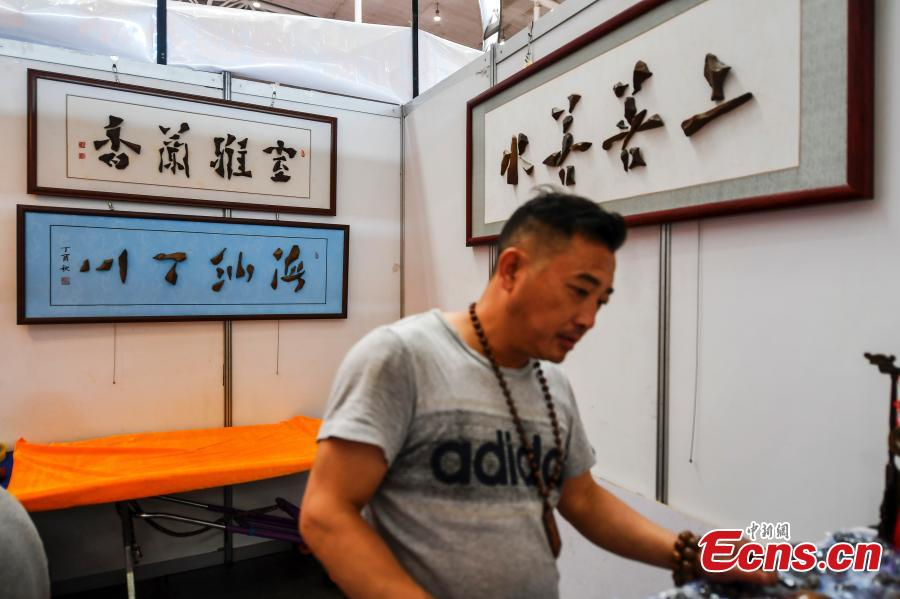 Rare stones are on display at an exhibition center in Urumqi, capital of northwest China\'s Xinjiang Uygur Autonomous Region, June 15, 2018. (Photo: China News Service/Liu Xin)