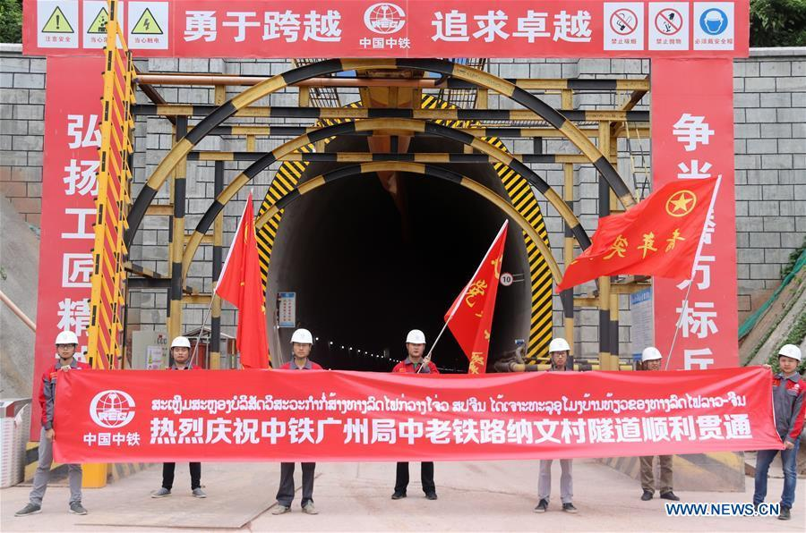 Workers celebrate the breakthrough of the second tunnel of the China-Laos railway in Laos\' northern town of Muangxay, Oudomxay Province, on June 12, 2018. The China Railway Guangzhou Engineering Group (CREC Guangzhou) has broken through the Ban Naven Tunnel of the China-Laos railway, securing steady progress in the construction of the railway project. (Xinhua/Liang Wendong)