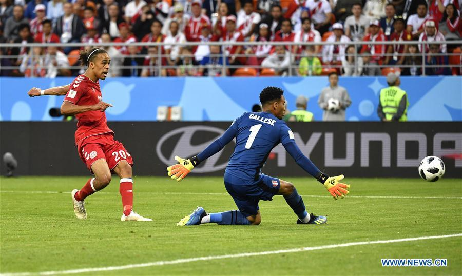 Yussuf Yurary Poulsen (L) of Denmark scores during a group C match between Peru and Denmark at the 2018 FIFA World Cup in Saransk, Russia, June 16, 2018. (Xinhua/He Canling)
