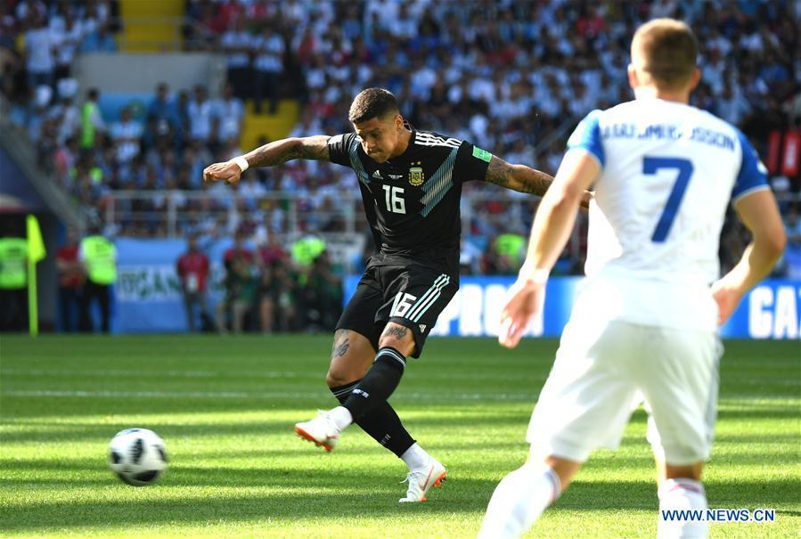 Marcos Rojo of Argentina shoots during a group D match between Argentina and Iceland at the 2018 FIFA World Cup in Moscow, Russia, June 16, 2018. (Xinhua/Du Yu)