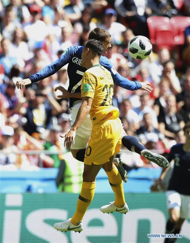 Antoine Griezmann (top) of France vies with Trent Sainsbury of Australia during a group C match between France and Australia at the 2018 FIFA World Cup in Kazan, Russia, June 16, 2018. (Xinhua/Wu Zhuang)