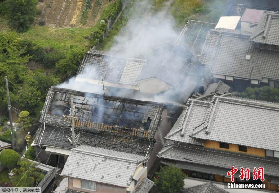 Smoke rises from a house where a fire breaks out, in Takatsuki, Osaka prefecture, western Japan, in this photo taken by Kyodo, June 18, 2018. (Photo/China News Service)
