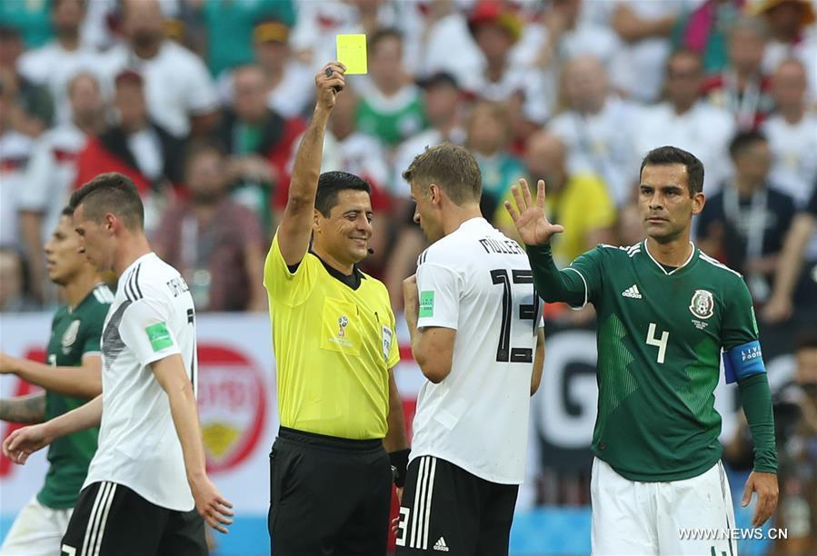 The referee gives a yellow card to Thomas Mueller (2nd R) of Germany during a group F match between Germany and Mexico at the 2018 FIFA World Cup in Moscow, Russia, June 17, 2018. (Xinhua/Xu Zijian)