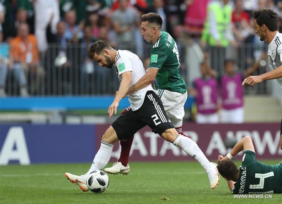 Marvin Plattenhardt (L) of Germany vies with Hector Herrera of Mexico during a group F match between Germany and Mexico at the 2018 FIFA World Cup in Moscow, Russia, June 17, 2018. (Xinhua/Xu Zijian)