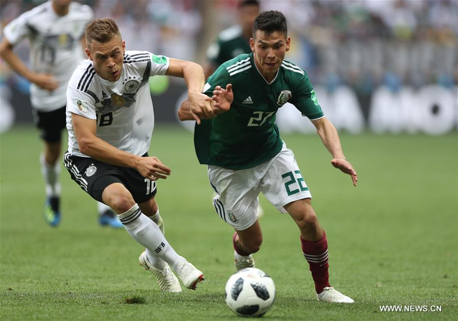 Joshua Kimmich (L) of Germany vies with Hirving Lozano of Mexico during a group F match between Germany and Mexico at the 2018 FIFA World Cup in Moscow, Russia, June 17, 2018. (Xinhua/Xu Zijian)