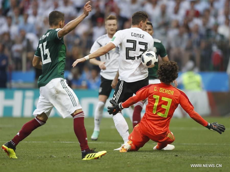 Mario Gomez (2nd R) of Germany vies with Guillermo Ochoa (1st R) of Mexico during a group F match between Germany and Mexico at the 2018 FIFA World Cup in Moscow, Russia, June 17, 2018. Mexico won 1-0. (Xinhua/Cao Can)