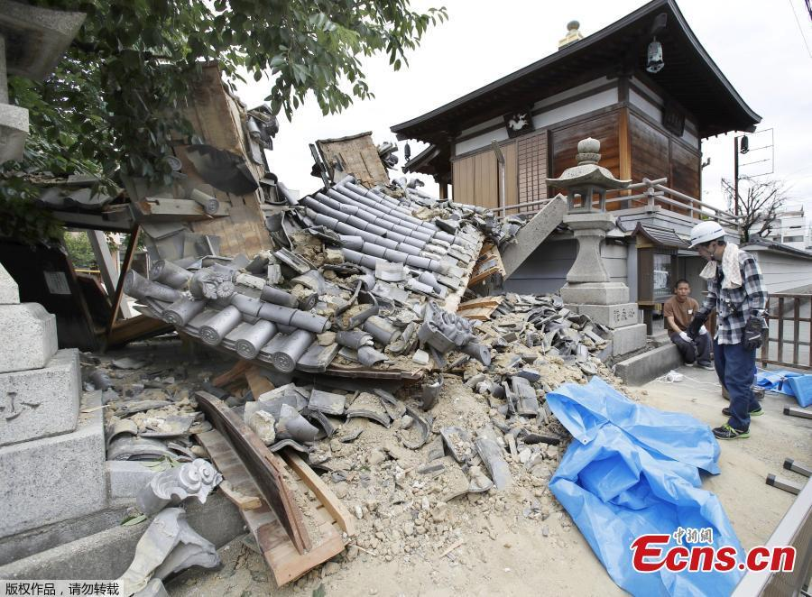 The gate of Myotoku-ji temple collapses after an earthquake hit Ibaraki City, Osaka, western Japan, Monday, June 18, 2018. A magnitude 6.1 earthquake shook Osaka, Japan's second-biggest metropolis, early on Monday, killing three people, halting factory lines in an industrial area and bursting water mains, government and company officials said. (Photo/Agencies)