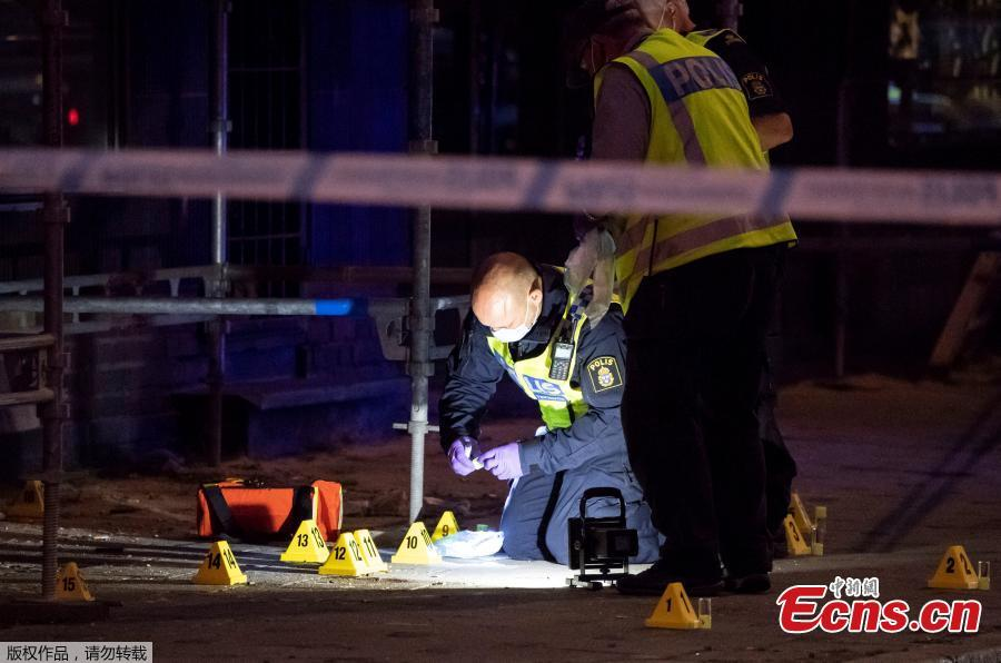 Police forensics investigate the scene after people were shot and injured outside an Internet Cafe in Malmo, southern Sweden, June 18, 2018. Swedish police said Tuesday that a shooting in the southern city of Malmo has resulted in the death of two people who sustained critical injures during the incident. The drive-by shooting occurred Monday night and all the five injured during the incident were sent to hospital, with one of them having succumbed to his wounds soon afterwards.(Photo/Agencies)