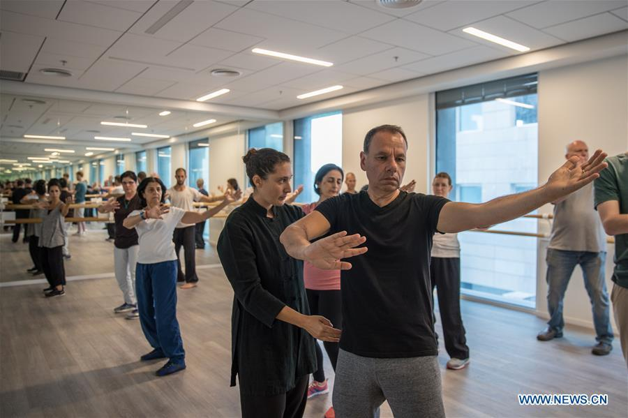 Israelis learn Tai Chi at the Chinese Cultural Center in Tel Aviv, Israel, on June 18, 2018. The Chinese Cultural Center provides locals with a series of courses introducing Chinese culture. (Xinhua/Guo Yu)