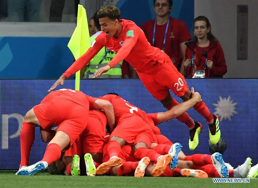 Players of England celebrate scoring during a group G match between Tunisia and England at the 2018 FIFA World Cup in Volgograd, Russia, June 18, 2018. (Xinhua/Liu Dawei)