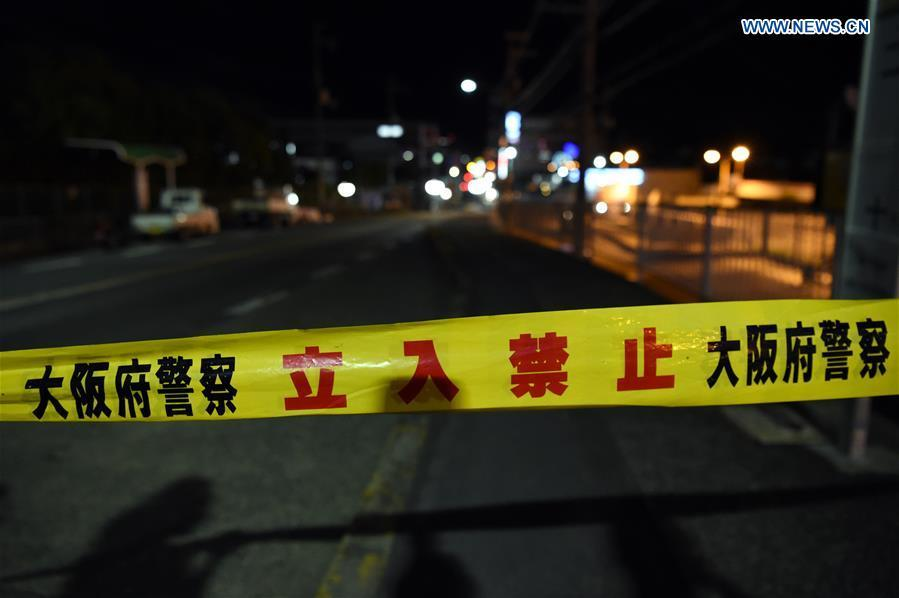 A site of a damaged road is blocked in Osaka, Japan, on June 18, 2018. At least three people have been confirmed dead and more than 90 others injured as a result of a 6.1 magnitude earthquake striking Osaka prefecture in western Japan on Monday morning. (Xinhua/Ma Ping)