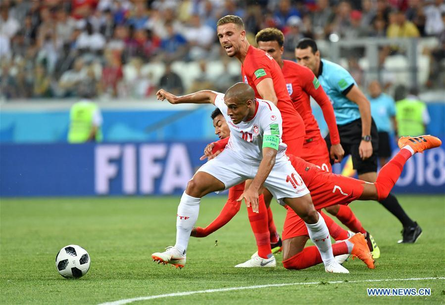 Wahbi Khazri(front)of Tunisia competes during a group G match between Tunisia and England at the 2018 FIFA World Cup in Volgograd, Russia, June 18, 2018. (Xinhua/Liu Dawei)