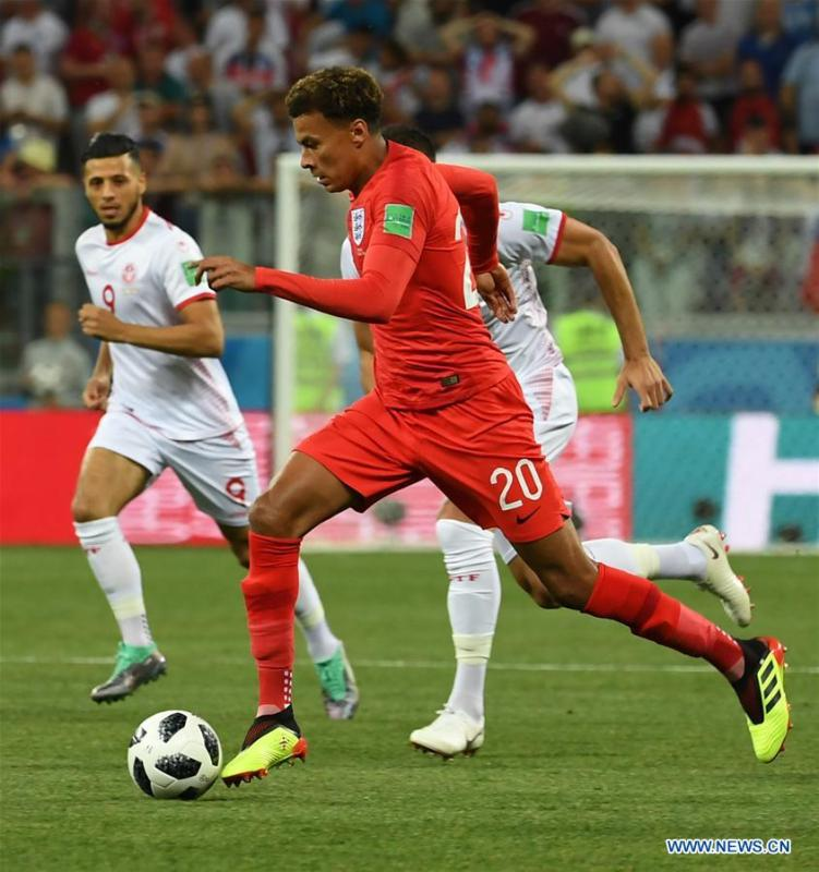 Dele Alli (front) of England competes during a group G match between Tunisia and England at the 2018 FIFA World Cup in Volgograd, Russia, June 18, 2018. (Xinhua/Chen Cheng)