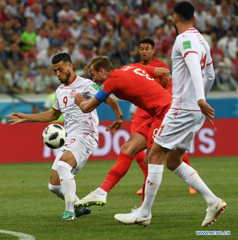 Harry Kane (C) of England shoots to score during a group G match between Tunisia and England at the 2018 FIFA World Cup in Volgograd, Russia, June 18, 2018. (Xinhua/Chen Cheng)