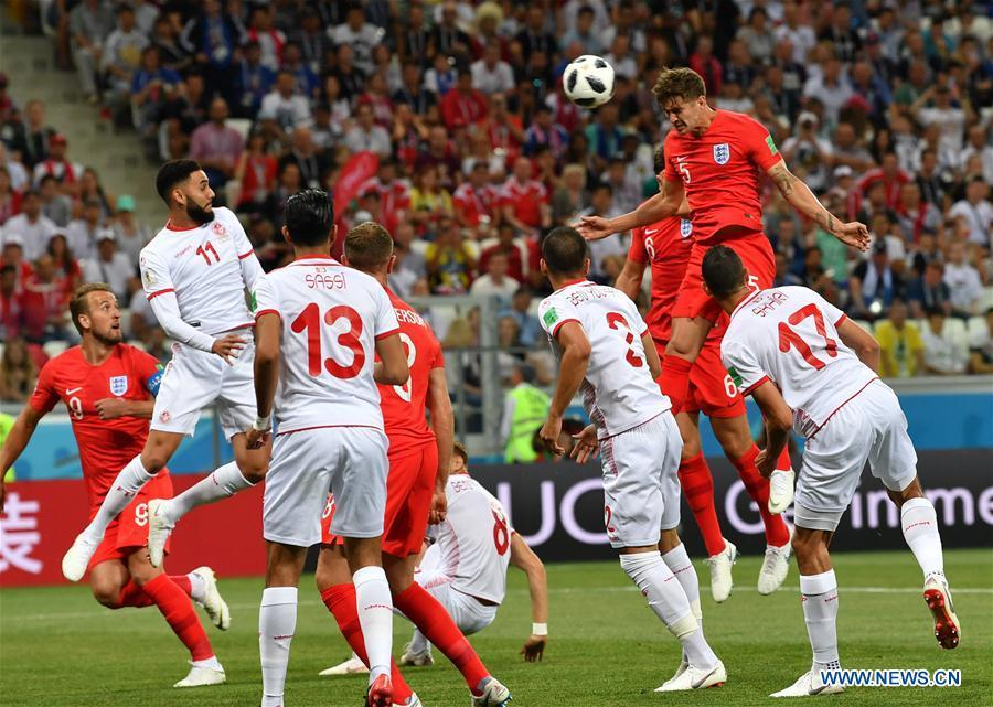 John Stones (R top) of England competes during a group G match between Tunisia and England at the 2018 FIFA World Cup in Volgograd, Russia, June 18, 2018. (Xinhua/Chen Cheng)