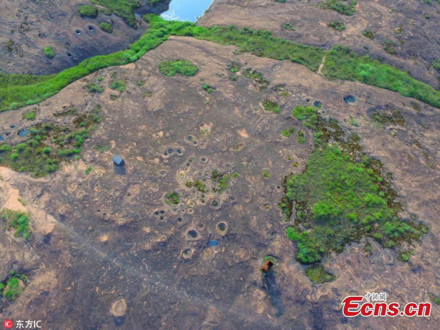 Photo taken on June 19, 2018 shows rare landforms left after the land was carved by glacier some two million years ago in Shennonggu Danxia scenic area in Anren County, Chenzhou City, Central China's Hunan Province. (Photo/IC)