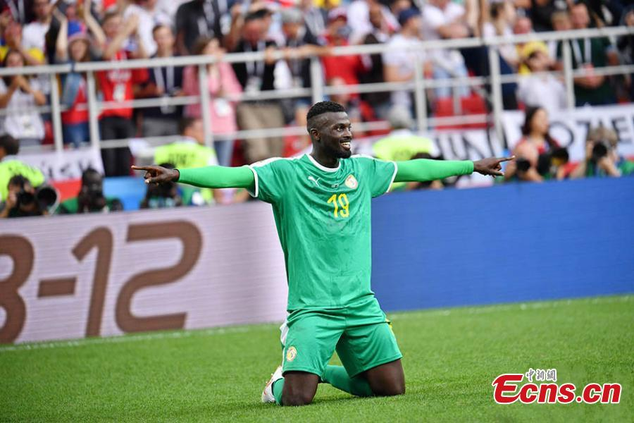 Senegal\'s M\'Baye Niang celebrates scoring a goal during a match against Poland in Spartak Stadium, Moscow, Russia, June 19, 2018. Senegal recorded the first African win at the 2018 World Cup when they beat Poland 2-1 on Tuesday thanks to a deflected Thiago Cionek own goal and a terrible error by Polish \'keeper Wojciech Szczesny. (Photo: China News Service/Mao Jianjun)