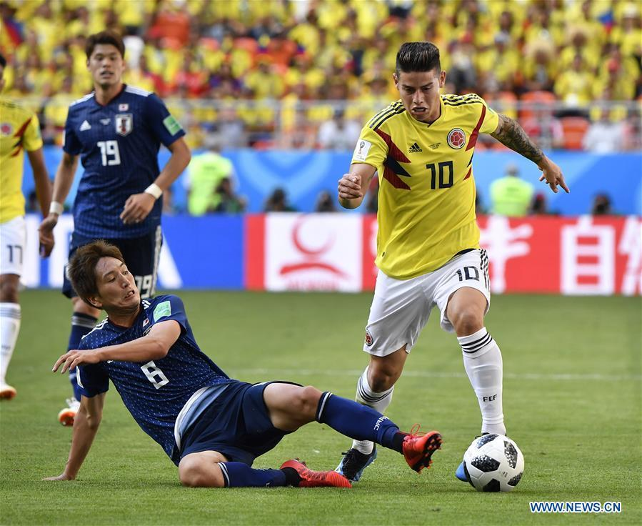 James Rodriguez (R) of Colombia vies with Genki Haraguchi (bottom) of Japan during a Group H match between Colombia and Japan at the 2018 FIFA World Cup in Saransk, Russia, June 19, 2018. Japan won 2-1. (Xinhua/He Canling)