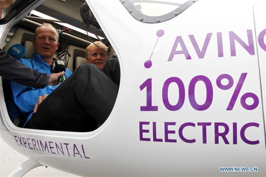 Norwegian airport operator Avinor\'s CEO Dag Falk-Petersen (R) and Minister of Transport and Communications Ketil Solvik-Olsen recieve interview while sitting in the two-seat electric aircraft, Alpha Electro G2, at the airport in Oslo, Norway, June 18, 2018. Norway\'s first electric aircraft took to the skies on Monday as the Nordic country that is known for electric cars vowed to electrify its aviation as well. (Xinhua/Liang Youchang)