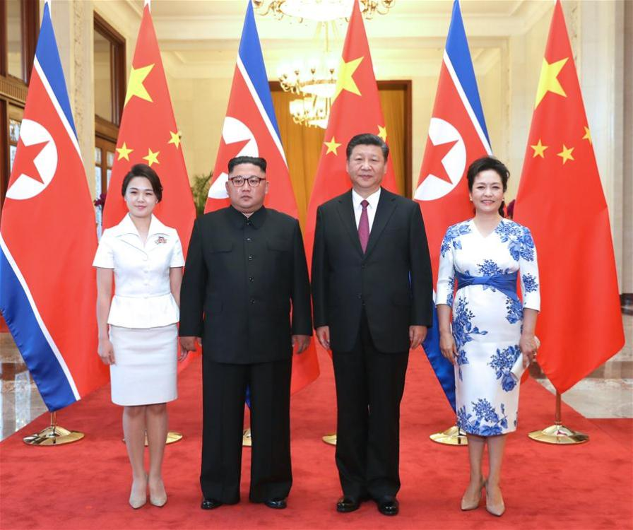 Xi Jinping (2nd R), general secretary of the Central Committee of the Communist Party of China (CPC) and Chinese president, and his wife Peng Liyuan (1st R) pose for photos with Kim Jong Un (2nd L), chairman of the Workers\' Party of Korea and chairman of the State Affairs Commission of the Democratic People\'s Republic of Korea (DPRK), and his wife Ri Sol Ju at the Great Hall of the People in Beijing, capital of China, June 19, 2018. Xi Jinping held talks with Kim Jong Un here on Tuesday. (Xinhua/Ju Peng)