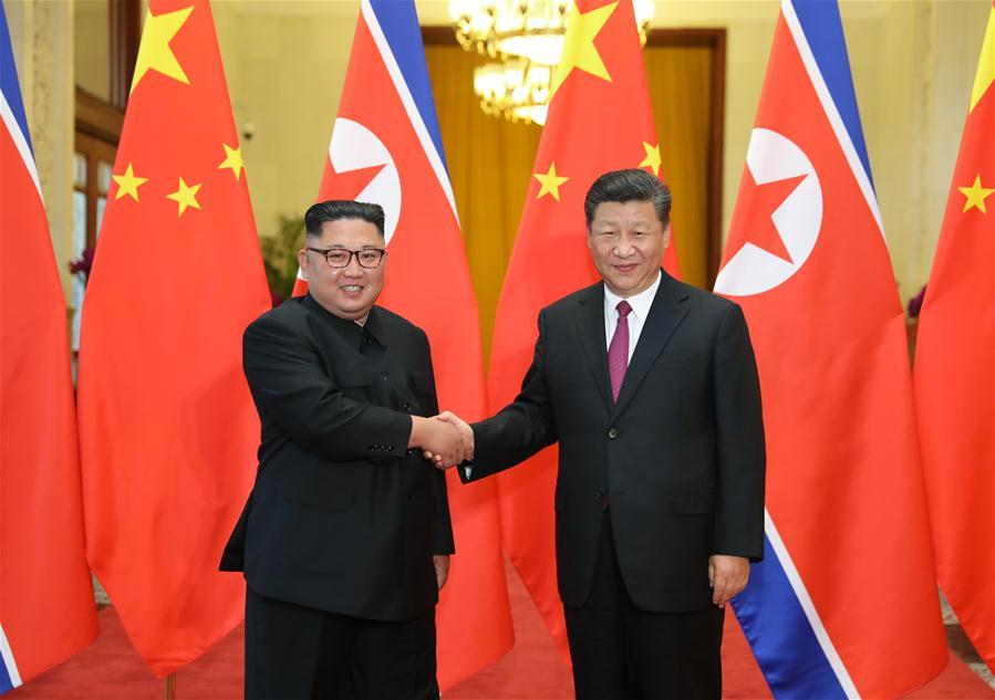Xi Jinping (R), general secretary of the Central Committee of the Communist Party of China (CPC) and Chinese president, holds talks with Kim Jong Un, chairman of the Workers\' Party of Korea and chairman of the State Affairs Commission of the Democratic People\'s Republic of Korea (DPRK), in Beijing, capital of China, June 19, 2018. (Xinhua/Ju Peng)