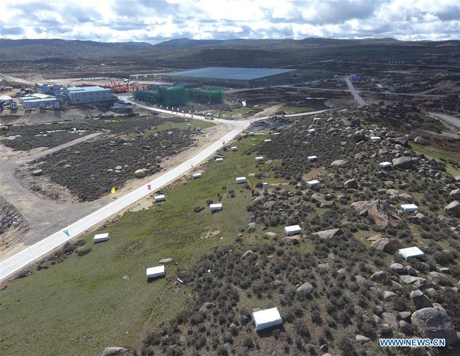 Aerial photo taken on June 19, 2018 shows the Electromagnetic Particle Detectors in the Large High Altitude Air Shower Observatory (LHAASO) which is under construction in Daocheng County, southwest China\'s Sichuan Province. An observatory for detecting cosmic rays is being built in Sichuan Province. The project, known as the LHAASO, is located in mountains of the eastern part of Qinghai-Tibet Plateau at an average altitude of 4,410 meters. (Xinhua/Liu Kun)