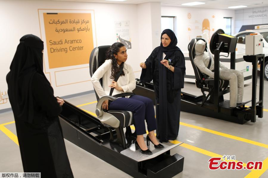A driving instructor (R) explains seat bells to trainees Amira Abdulgader and Maria Al-Faraj (C) at Saudi Aramco Driving Center in Dhahran, Saudi Arabia, June 6, 2018. (Photo/Agencies)