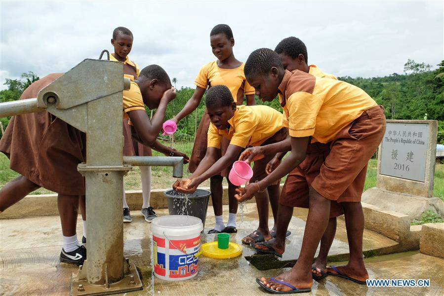 Children fetch water from a borehole in Guayotse Village, Eastern Region, Ghana, on June 18, 2018. The government of China is providing 1,000 boreholes for hundreds of rural communities in six out of the ten regions of Ghana to bring clean water to the people. (Xinhua/Zhao Shuting)