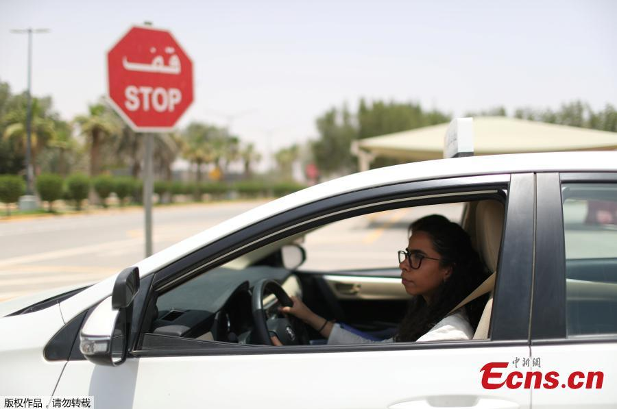 Trainee Maria al-Faraj stops the car at a stop sign during a driving lesson with her instructor at Saudi Aramco Driving Center in Dhahran, Saudi Arabia, June 6, 2018. (Photo/Agencies)