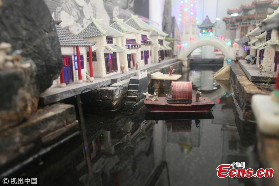 Yu Zuofu, an enthusiast of miniature buildings and landscapes, shows his creation in Anshan City, Liaoning Province. Yu, 79, developed the interest in making very small buildings with waste chopsticks or ice lolly sticks after his retirement. Among the more than 200 miniature creations, his first work was a replica of Daguanyuan, or Grand View Garden, depicted in the classical novel Dream of the Red Chamber. (Photo/VCG)