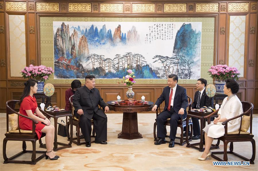 Xi Jinping (3rd R), general secretary of the Central Committee of the Communist Party of China (CPC) and Chinese president, meets with Kim Jong Un (3rd L), chairman of the Workers\' Party of Korea (WPK) and chairman of the State Affairs Commission of the Democratic People\'s Republic of Korea (DPRK), at the Diaoyutai State Guesthouse in Beijing, capital of China, June 20, 2018. Xi\'s wife Peng Liyuan (1st R) and Kim\'s wife Ri Sol Ju (1st L) also attended the meeting. (Xinhua/Li Xueren)