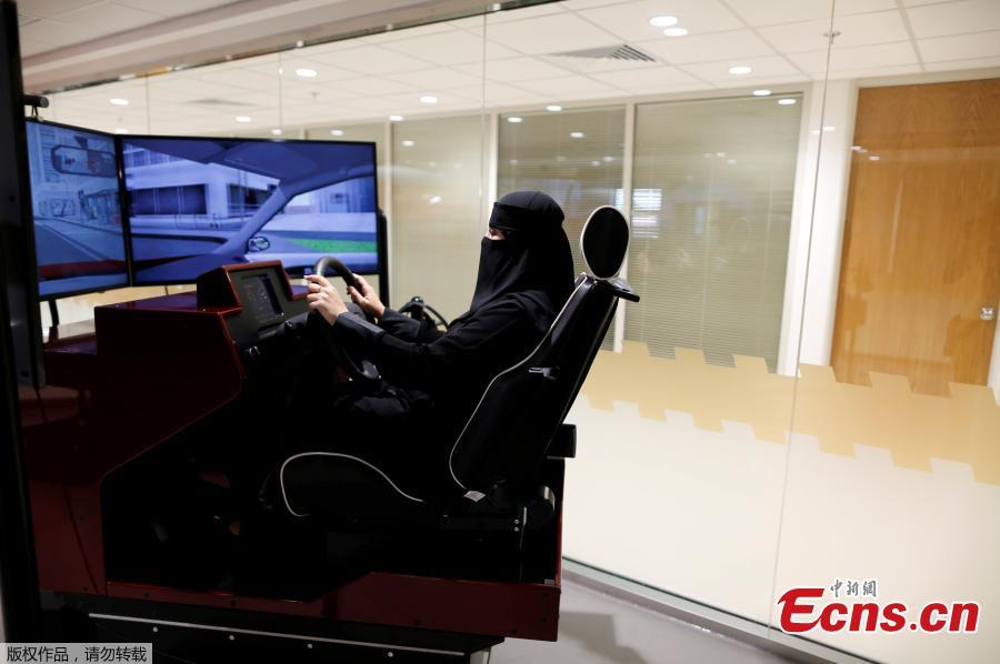 Trainee Amira Abdulgader practices with a screen in front of her during a driving lesson at Saudi Aramco Driving Center in Dhahran, Saudi Arabia, June 6, 2018. (Photo/Agencies)