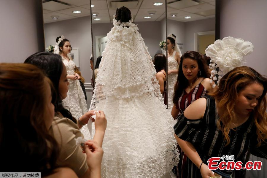 A model is fitted for the 14th Annual Toilet Paper Wedding Dress Contest in Manhattan, New York, U.S., June 20, 2018. (Photo/Agencies)