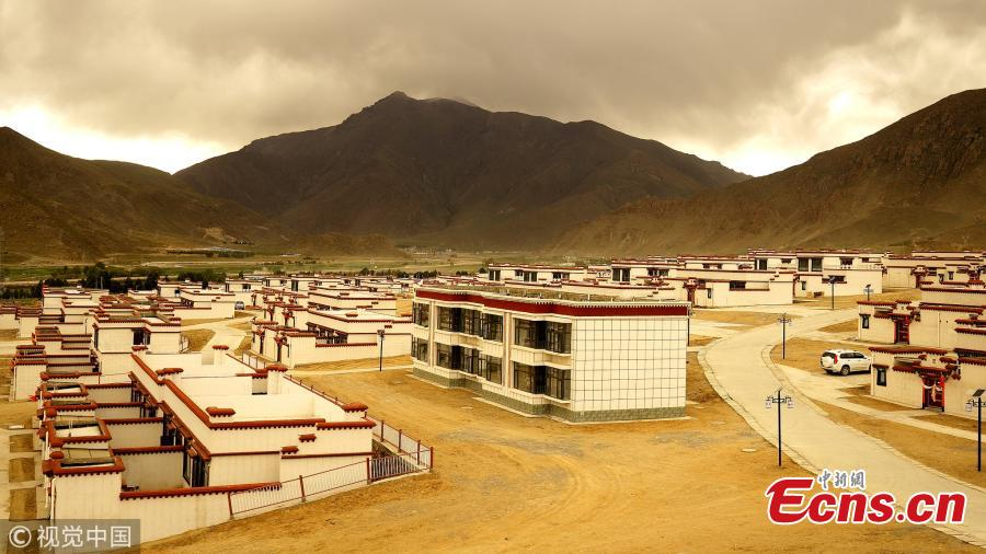 A view of newly built homes for relocated residents in Doilungdeqen District, Lhasa City, Southwest China's Tibet Autonomous Region, June 20, 2018. Residents who once lived in Rongma Township of Nyima County, which averages 5,000 meters above sea level and faces difficulties in poverty alleviation, have been relocated to new homes at an altitude of 3,800 meters. The ecological relocation stretching more than 1,000 kilometers can also help conserve wild animals on the Northern Tibet Plateau. (Photo/VCG)