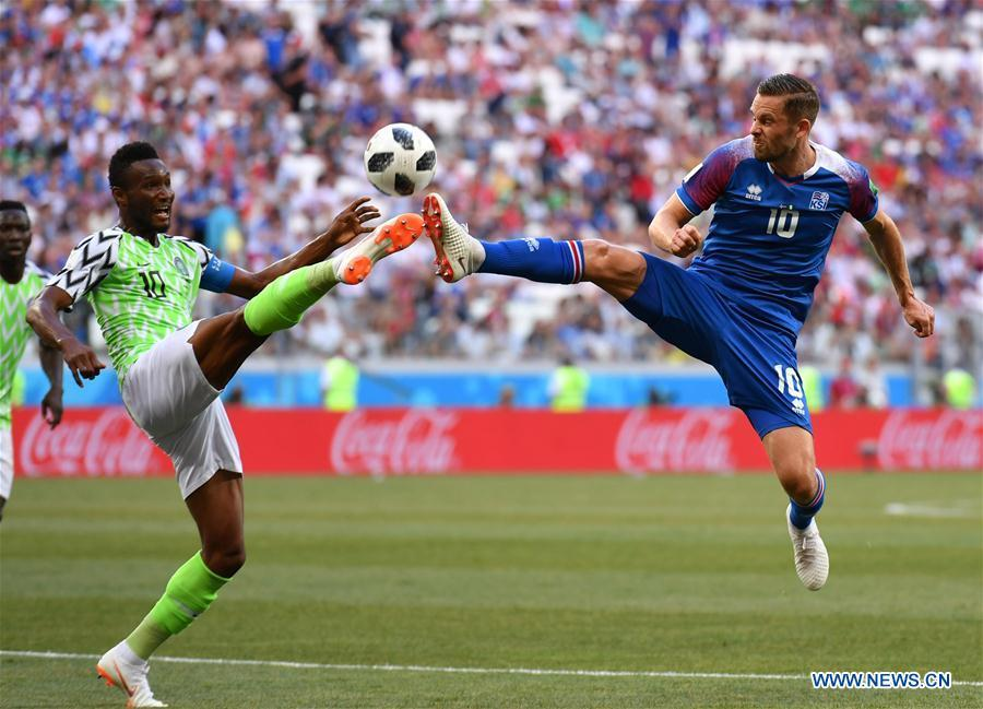 Gylfi Sigurdsson (R) of Iceland vies with John Obi Mikel of Nigeria during the 2018 FIFA World Cup Group D match between Nigeria and Iceland in Volgograd, Russia, June 22, 2018. (Xinhua/Lui Siu Wai)