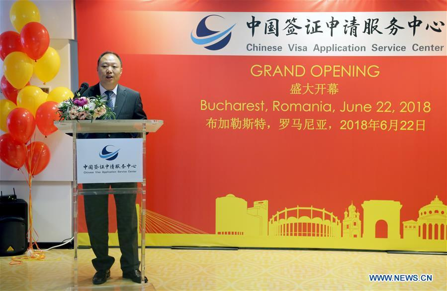 Minister Counsellor Tu Jiang, charge d\'affaires a.i. of the Chinese Embassy in Romania, addresses an opening ceremony of a Chinese visa application service center in Bucharest, capital of Romania, on June 22, 2018. China opened here on Friday a visa application service center, the first in Central and Eastern Europe (CEE), to facilitate the visa processing and provide better service to Romanian applicants wishing to visit China. (Xinhua/Chen Jin)