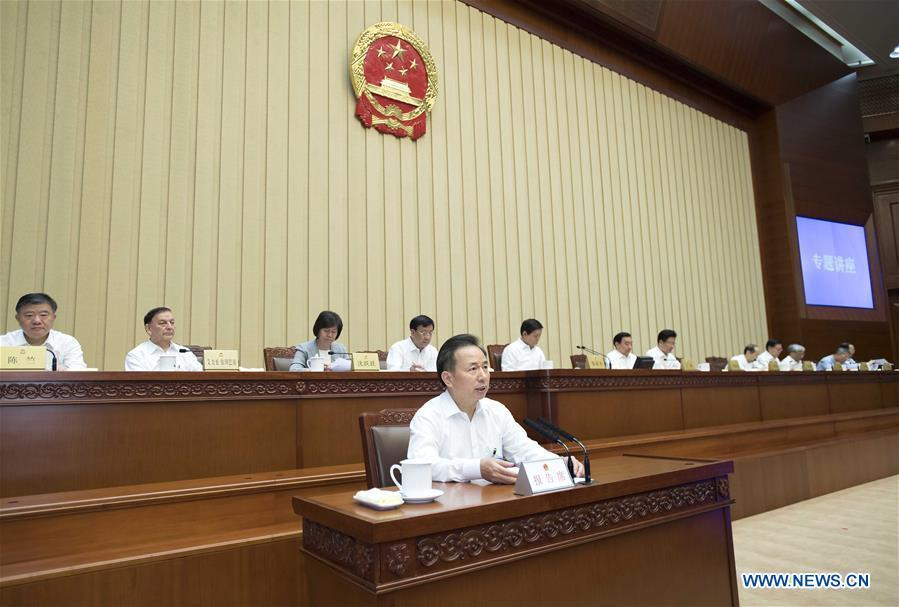 Minister of Ecology and Environment Li Ganjie (front) holds a lecture on the goal of building a Beautiful China after the conclusion of a bimonthly session of the 13th National People\'s Congress (NPC) Standing Committee at the Great Hall of the People in Beijing, capital of China, June 22, 2018. Li Zhanshu, chairman of the NPC Standing Committee, presided over the bimonthly session\'s closing meeting. (Xinhua/Li Tao)