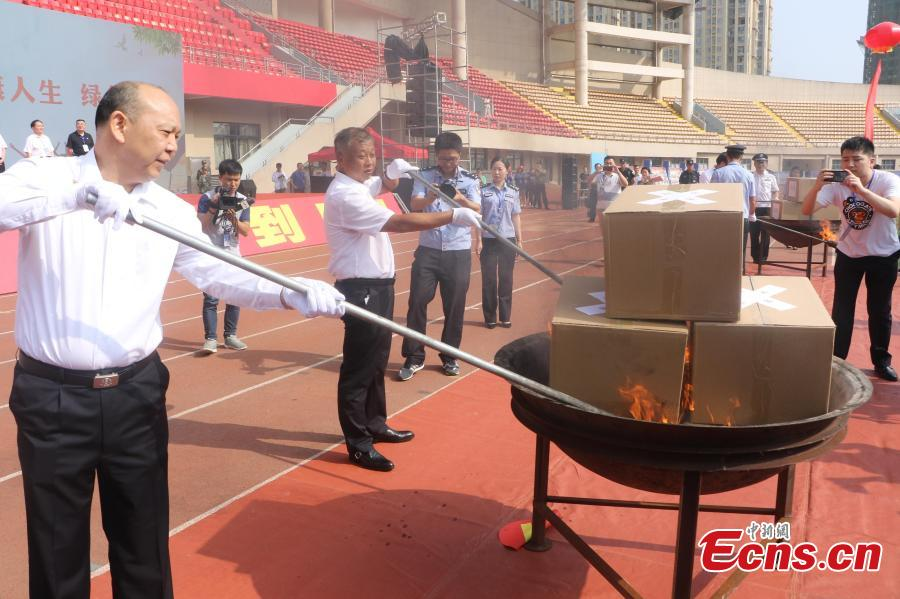 Police burn 297 kilograms of seized heroin, methamphetamine, morphine and other drugs in an event to mark the upcoming International Day Against Drug Abuse and Illicit Trafficking in Linquan County, East China's Anhui Province, June 23, 2018. The United Nations\' International Day Against Drug Abuse and Illicit Trafficking falls on June 26 each year. (Photo: China News Service/Zhao Qiang)